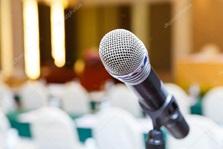 Vign_depositphotos_114272926-stock-photo-microphone-in-meeting-room
